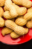 Peanuts in shell on dark background, close up. Peanuts, Arachis hypogaea, in shell on dark background, close up, selective focus Royalty Free Stock Photos