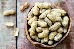 Peanuts in shell pod in bowl Stock Photo