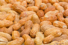 Peanuts in shelles on wooden table as a background Royalty Free Stock Photos