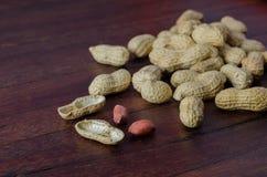 Peanuts in shells on dark board 2 Stock Photo
