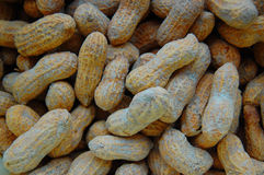 Peanuts in shells, one upon the other Royalty Free Stock Photos