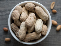 Peanuts in shells in a white bowl Royalty Free Stock Image