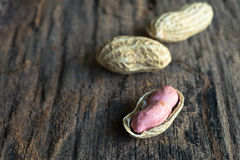 Peanuts in shells. On wood background royalty free stock photography