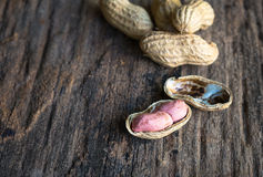 Peanuts in shells. On wood background Royalty Free Stock Photo