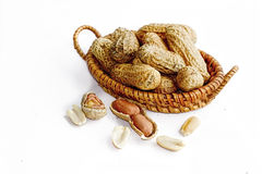 Peanuts in small wicker baskets and isolated on white Stock Image