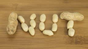 Peanuts Spelling Out Nut Royalty Free Stock Image