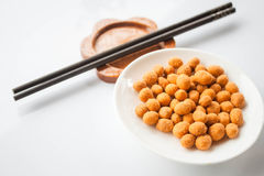 Peanuts with spicy seasoning and chopsticks Royalty Free Stock Image