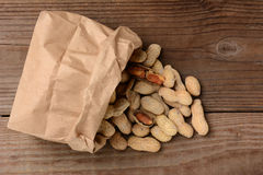 Peanuts Spilling From Brown Paper Bag Royalty Free Stock Image