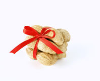 Peanuts tied with a bow. On white background Stock Photography