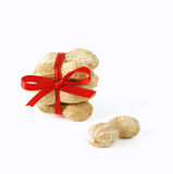 Peanuts tied with a bow. On white background stock photos
