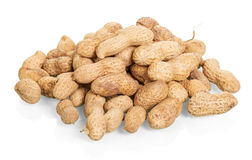 Peanuts unpeeled close-up isolated on white. Royalty Free Stock Photos