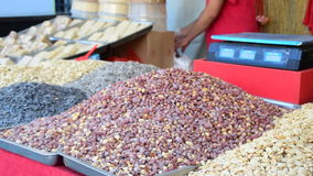 Peanuts and various types of nuts on the market stock video