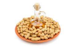 Peanuts and vegetable oils isolated on white background. Royalty Free Stock Photo