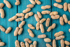 Peanuts on vintage blue wood table Stock Photo