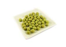 Peanuts wasabi on plate Stock Photos