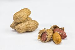 Peanuts on a white background. Peanuts in a shell on a white background macro Stock Photo