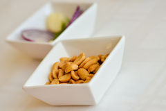 Peanuts in a white ceramic bowl Stock Image