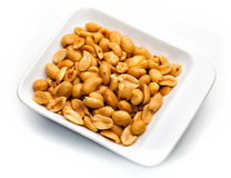 Peanuts in white container Royalty Free Stock Photos