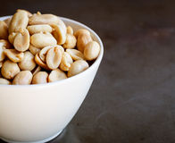 Peanuts in white plate. Peanuts in a white plate Royalty Free Stock Images