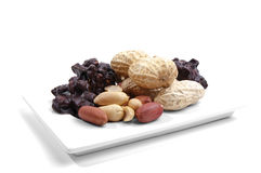 Peanuts on a white plate Royalty Free Stock Photos