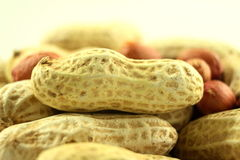 Peanuts whole and peeled closeup Royalty Free Stock Images