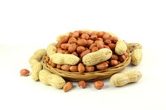 Peanuts whole and peeled in white  background Royalty Free Stock Photos
