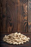 Peanuts on wood background. Peanut in shell texture and background. Peanuts texture. Healthy food. Close up view of shelled peanuts in wooden background Stock Photography