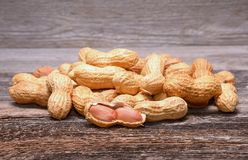 Peanuts on wooden background Royalty Free Stock Images