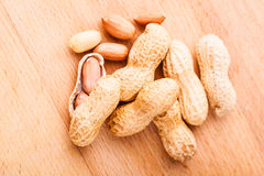 Peanuts on wooden board Royalty Free Stock Photos