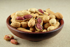 Peanuts in a wooden bowl. Peanuts in a wooden bowl on natural background Royalty Free Stock Image