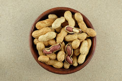 Peanuts in a wooden bowl. Stock Images