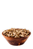 Peanuts in wooden bowl Royalty Free Stock Photo