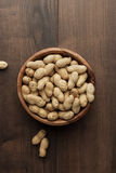 Peanuts in wooden bowl on the table Royalty Free Stock Photography