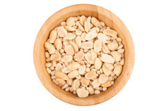 Peanuts in wooden bowl top view. Peanuts in wooden bowl isolated on white background Stock Photos
