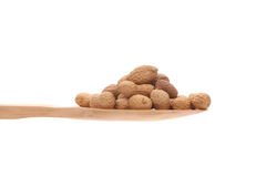 Peanuts  on a wooden spoon Stock Images