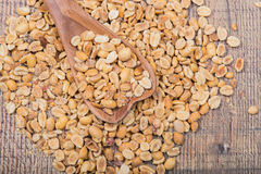 Peanuts with a wooden spoon Royalty Free Stock Images