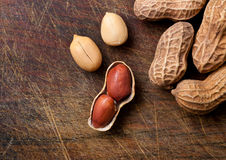 Peanuts on a wooden table. Royalty Free Stock Images