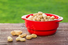 Peanuts on wooden table Stock Image
