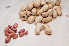 Peanuts on the wooden table Stock Image