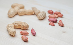 Peanuts on the wooden table Royalty Free Stock Photo