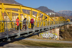 Peaple walking on pedestrian and cycle  yellow steel bridge with Royalty Free Stock Photography