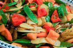 Peapods, patatas, pimientas rojas Imagenes de archivo
