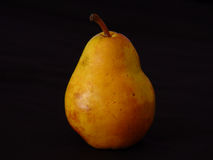 Pear. A bartlett pear photographed on black with colored flash Stock Photo