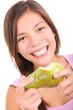 Pear. Beautiful young woman eating a pear with a happy smile. Isolated on white background stock images