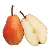 Pear. Whole and half pear isolated royalty free stock photos