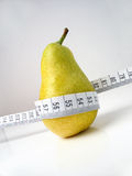 Pear. Yellow Pear with tape measure Royalty Free Stock Photo
