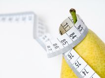 Pear. With tape measure. Fruit Royalty Free Stock Photography