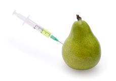 Pear. With the punctured syringe sideways on a white background stock image