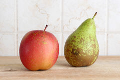 A pear and anapple on a chopping board Royalty Free Stock Image