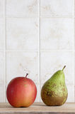 A pear and anapple on a chopping board, space for text Stock Images